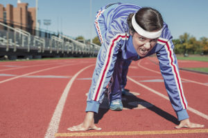Woman Sprinting on Track